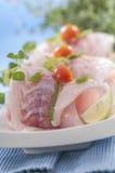 Raw white fish fillets with tomatoes and fresh oregano & Lemon slice Stock Images