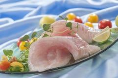 Raw white fish fillets with tomatoes and fresh oregano & Lemon slice Royalty Free Stock Image