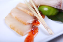 Raw white fish with sauce Stock Photos