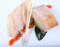 Raw white fish with sauce Royalty Free Stock Photography