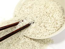 Raw white rice with chop sticks Stock Photo