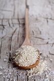 Raw white rice in spoon Royalty Free Stock Photo