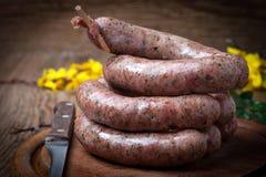 Raw white sausage. Stock Photos