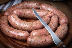 Raw white sausage. Royalty Free Stock Images