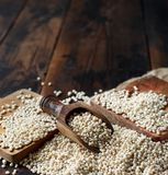 Raw White Sorghum grain. On a wooden table Royalty Free Stock Photography