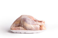 Raw whole chicken in plastic wrapping Royalty Free Stock Photo