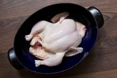 Raw whole chicken. Raw chicken is prepared in a pan, the whole chicken in the pan will bake in the oven Royalty Free Stock Photo