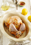 Raw whole chicken stuffed lemon and spices preparing for cooking Royalty Free Stock Photography