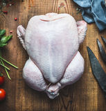 Raw whole chicken or turkey on wooden kitchen table background Royalty Free Stock Photography