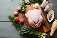 Raw whole chicken stock images