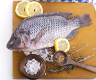 Raw Whole Fish. On a cutting board Royalty Free Stock Photography