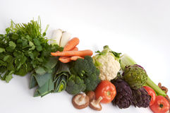 Raw Whole Foods. Colorful raw vegetables lines up in a row royalty free stock photo