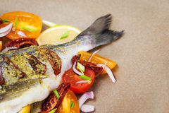 Raw whole sea bream fish and vegetables ingredients Royalty Free Stock Images