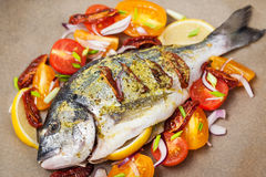 Raw whole sea bream fish and vegetables ingredients Royalty Free Stock Photography