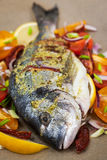Raw whole sea bream fish and vegetables ingredients Stock Photos