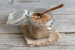 Raw whole spelt in a glass jar Royalty Free Stock Image