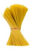 Raw Whole-Wheat Spaghetti Pasta in Bundle Isolated on White Background Stock Photo