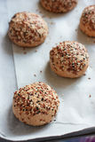 Raw wholegrain buns on the oven-tray before baking Royalty Free Stock Photography