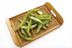 Raw winged beans (Psophocarpus tetragonolobus) on bamboo tray Stock Photography