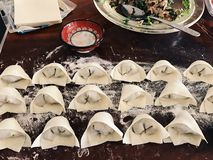 Raw wonton making. In the kitchen, Chinese traditional food stock photos