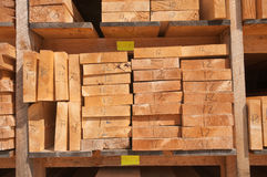 Raw wood planks at lumbermill. Numbered wood planks stacked at lumber mill in Ontario, Canada Stock Images