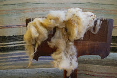 Raw wool on the old distaff. Raw sheep wool on the old distaff Royalty Free Stock Photography
