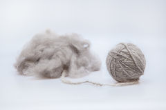 Raw wool yarn coiled into a ball. Persian cat raw wool yarn coiled into a ball on white background Stock Images