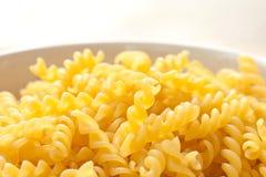 Raw yellow macaroni Stock Photography