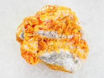 Raw yellow Orpiment crystals on white dolomite. Macro shooting of natural mineral rock specimen - raw yellow Orpiment crystals on white dolomite stone on white Royalty Free Stock Photos