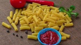 Raw yellow pasta, macaroni on sack background stock video