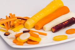 Raw yellow, white, orange, red carrots. Variety of raw carrots, vitamines, diet and health Stock Images