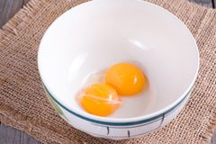 Raw yolks in a ceramic bowl Royalty Free Stock Photography