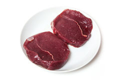 Raw zebra steaks on a plate Royalty Free Stock Photo