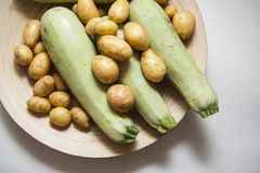 Raw zucchini and potato Stock Photo