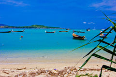 Rawai beach. A beach is beautiful, the green tree, the green sea, the sky is blue, the fishing boat Royalty Free Stock Photos
