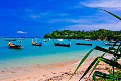Rawai beach. A beach is beautiful, the green tree, the green sea, the sky is blue, the fishing boat Royalty Free Stock Photo