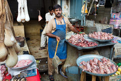 Raja Bazaar in Rawalpindi, Pakistan. RAWALPINDI, PAKISTAN - JULY 16: Unidentified Pakistani man sells meat at Raja Bazaar on July 16, 2011 in Rawalpindi Stock Image