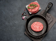 RawBeef Meat Burger cutlets. Raw Ground Beef Meat Burger cutlets. Top view Royalty Free Stock Photography