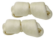 Rawhide dog chew bones. Two large rawhide dog chew bones isolated on white Stock Photo