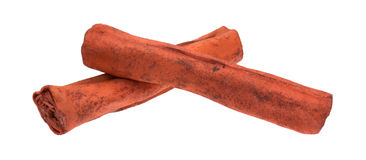 Rawhide fetch sticks for dogs on white background. Side view of two dyed red rawhide fetch sticks for dogs isolated on a white background stock image