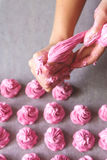 Raws of homemade marshmallow dessert making with cream injector Royalty Free Stock Photos