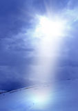 Ray. Sun shines through thick clouds Royalty Free Stock Image