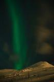 Ray of Aurora polaris. Above the slope of mountain stock photos