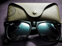 Ray-Ban Original Wayfarer Classic Black Sunglasses. An `Original Wayfarer Classic Black` Ray-Ban Sunglasses with it`s case Royalty Free Stock Photography
