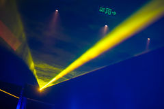 Ray of laser yellow light in ultraviolet. At disco club Royalty Free Stock Photos