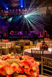 Ray of light. Of a concert in a ballroom with table and chairs Royalty Free Stock Photos