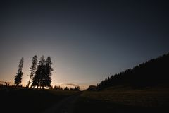 Ray of light breaks through the sky at sunset and hit tree solitary Royalty Free Stock Photography