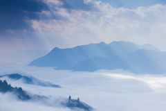 Ray of light , cloud and mountain Stock Images