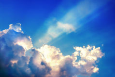 Ray of light through cloud Stock Images