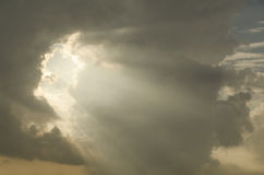 Ray of light coming out from cloud Stock Photos